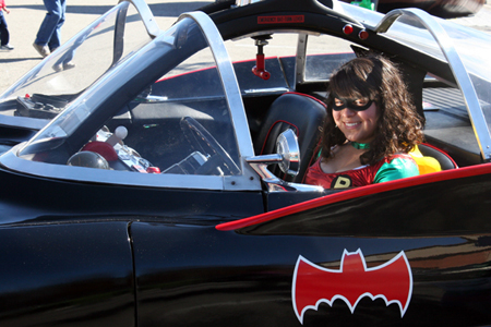 Robin fan sits in Batmobile